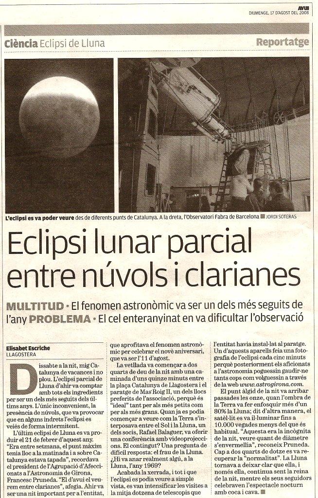 Eclipsi parcial entre núvols i clarianes.